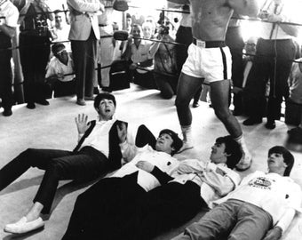 Cassius Clay Muhammad Ali Celebrates Mock Victory Over The Beatles - 5X7 or 8X10 Photo (ZY-159)