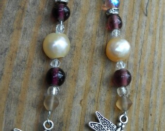 Pearl and dragonfly earrings