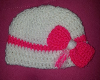 White baby hat with neon pink bow