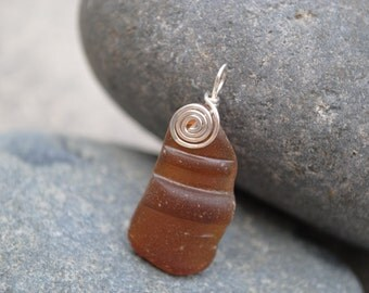 Brown bottle top seaglass with swirl