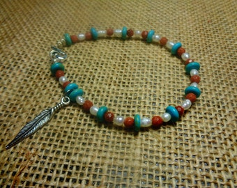 Turquoise, Fresh Water Pearl, and Goldstone Bracelet