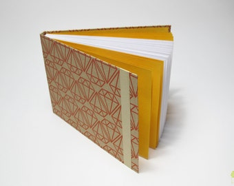 Journal paper with geometric patterns, write or draw (pages)