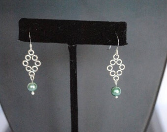 Sterling silver dangle with a green glass pearl