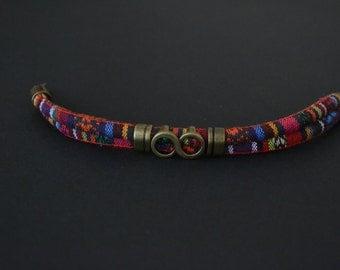 Textile and bronze bracelet