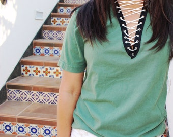 olive tee with black trim and white lace up