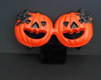 50's Orange Plastic Smiling Jack O' Lantern Eye Glasses with Black Witches made by Fosta Grant