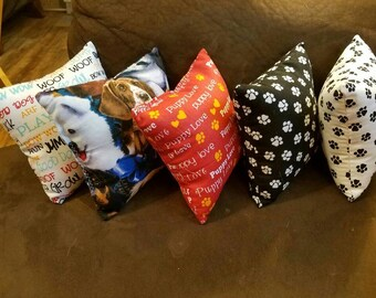 4 Homemade stuffed dog toys with squeaker.