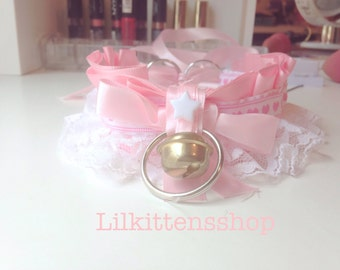 Pink and white lacey collar