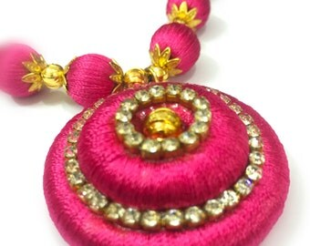 Pink and gold necklace with white stones