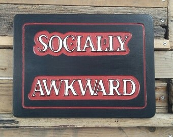 Socially Awkward hand carved plaque