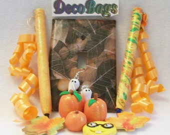Seasons Deco Bags of the month club subscriptions include: pens magnets window decor switch plate covers earrings pins