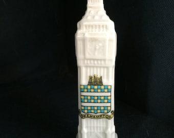 Tower Clock (? Big Ben) with Okehampton crest.