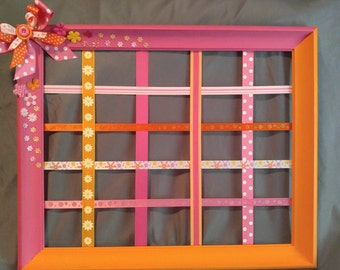 Beautiful orange and pink picture frame hair bow holder!
