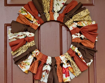 Autumn Wreath with falling leaves and Fall colored fabrics