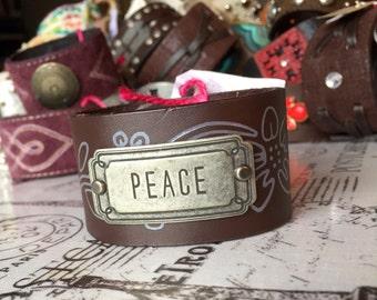 Brown cuff bracelet.