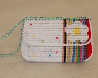 Plastic canvas purse with white flower
