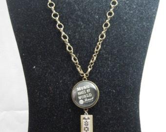 Music makes my world go around antique goldtone Sew Forgiven necklace-069
