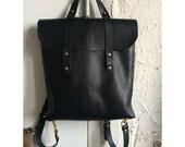 Flux rucksack tote in all black.