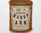Can of 100% organic Whoop *ss iron on patch applique in rust and sand felt, gag gift,patches for jackets, joke gift, felt patch