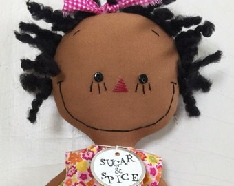 cloth rag doll African American handmade in a bright floral dress