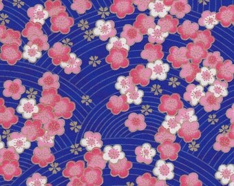 Chiyogami or yuzen paper - pink and white cherry blossoms on an ultramarine blue background with gold plum blossom accents, 9x12 inches