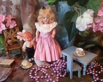 """Adorable print of little antique dolls in a scene with flowers, old miniature furniture, tiny teacups and old fabrics, 8"""" x 10"""" color print"""