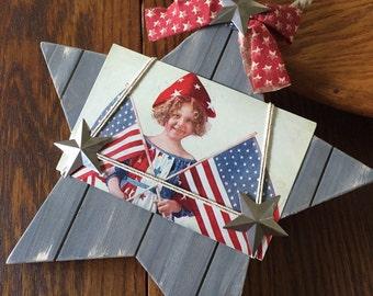 Patriotic vintage postcard on wood star for 4th July Americana decor