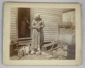 Black History 1890 Cabinet Card of Negro Woman feeding her cats in St. Augustine Florida.