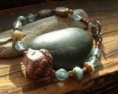 Owl Czech glass polymer clay beaded bracelet in aqua blue and cream verdigris copper clasp cream and aqua flowers woodland nature strung