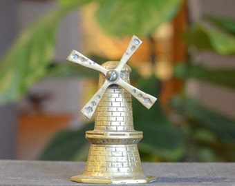 Small vintage brass windmill with blades that spin