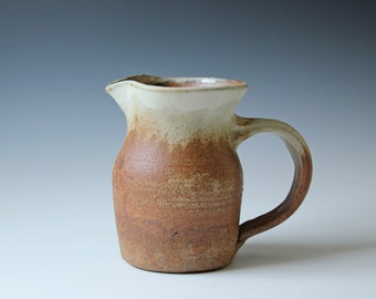 Modern studio art pottery pitcher or vase, simple rustic, natural brown and creamy white color