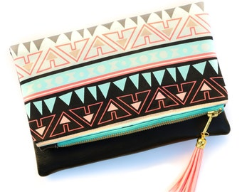 Boho Tassel Clutch in Coral, Turquoise, and Black Tribal Ikat Print with Black Vegan Leather and Turquoise and Gold zipper close