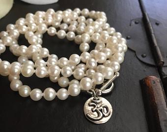 pearl necklace wrap bracelet yoga style sterling silver ohm charm
