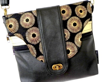 Cross body zipper vegan bag in black and gold starburst fabric flap.