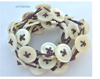 Bracelet button jewelry made of antique shell  buttons beaded on purple leather cord