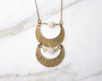 Brass crescent moon necklace with rose quartz, moon phases
