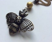 Honey bee pendant necklace. Antiqued brass bee pendant.