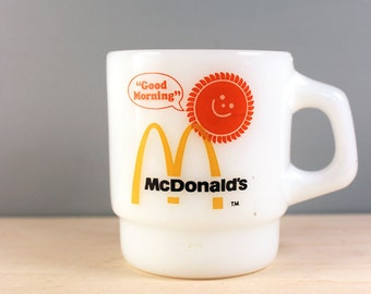 Good morning. Vintage 1970s McDonalds advertising milk glass mug. Fire King.