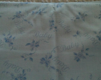 Childrens  Novelty Fabric BABY in Script on Lt. Blue on Pink