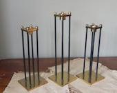 Vintage brass and black metal candleholders three statuesque columns columnal elegant mid century modern trio three black tie