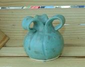 Sweet little matte green bud vase
