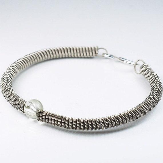 guitar string bracelet silver with clear glass bead guitar. Black Bedroom Furniture Sets. Home Design Ideas