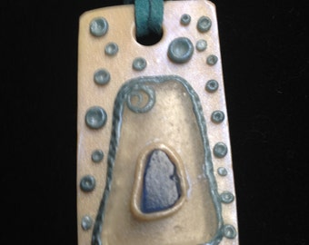 Sea glass and clay pendant necklace