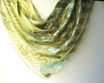 luxurious vintage 80s olive green silk soie  ,large scarf with  abstract sea shell print and wide strips. Made by Adrienne Vittadini.