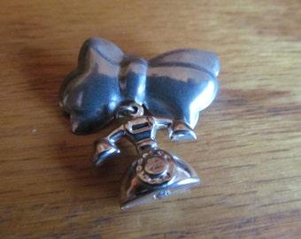 telephone bow brooch