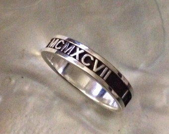 Custom made roman numerals sterling silver ring. Made with your dates.