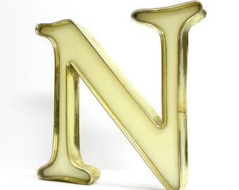 N is for NAUGHTY . gold rimmed cream marquee letter . vintage sign letter . rare color combo in a neat industrial style