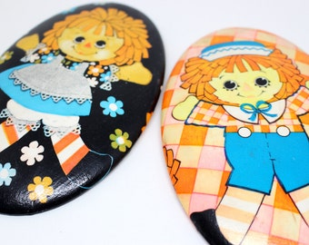 Cute 1970s Raggety Ann and Andy wall hangings . Decoupage on chalkware . Great for baby showers or kids' rooms . Girls and boys will love