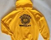 Vintage UC Berkeley California University hoodie sweatshirt, golden yellow, navy blue screenprint, men's large / women's extra large