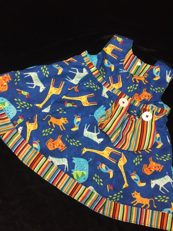 Reversible Blue jungle animal button dress sizes 1-5 years